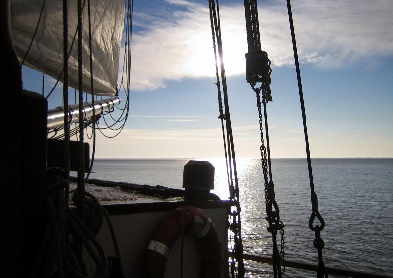 Condoleancekaarten - Boot op rustig water met ondergaande zon