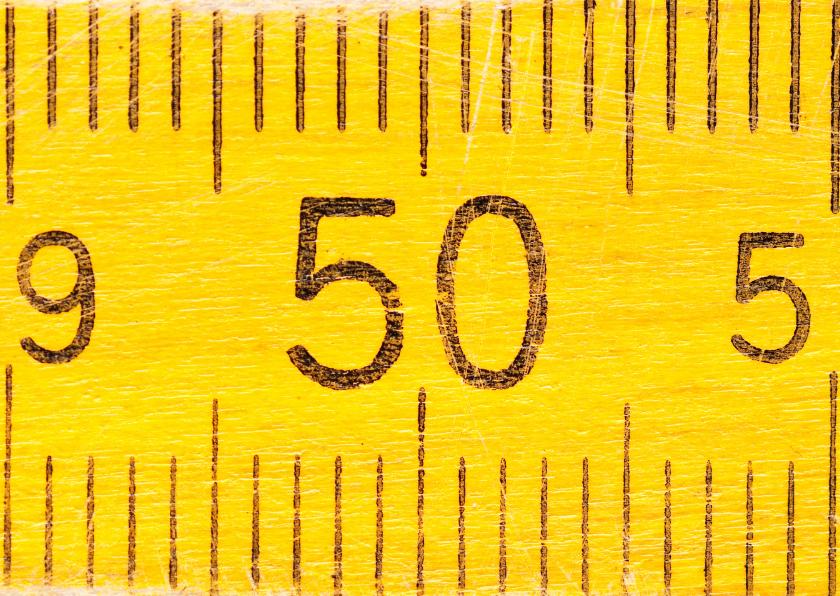 50 jaar op gele duimstok 1