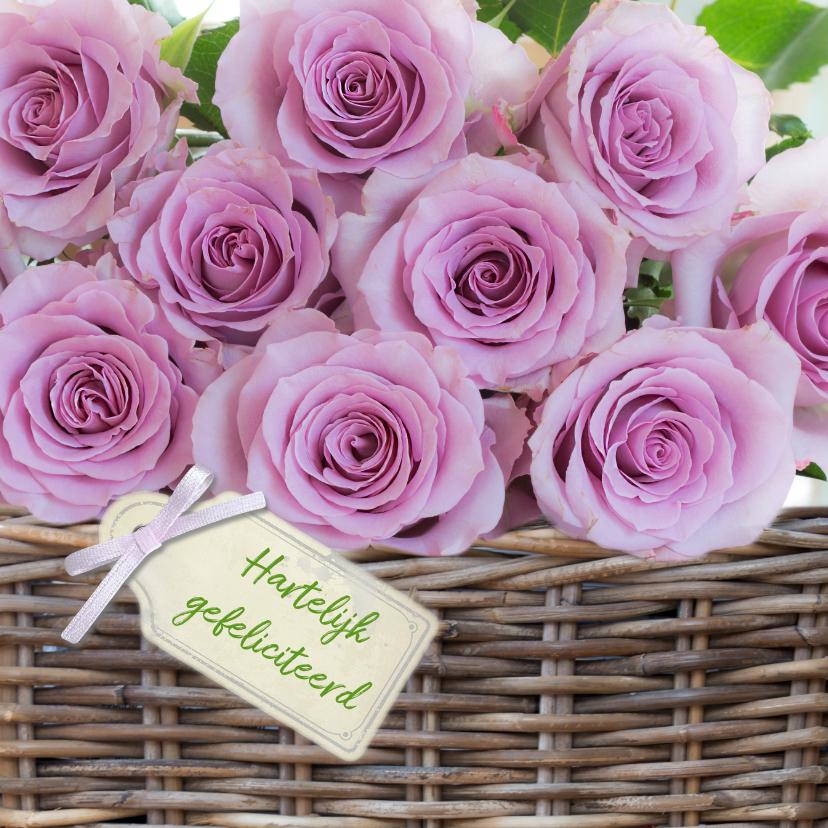 Verjaardagskaarten - Mand met roze rozen met tekstlabel